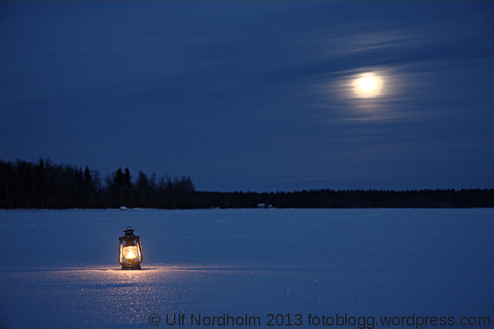 A kerosene lamp in moonlight
